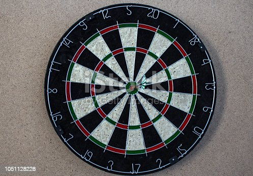 istock a darts on the wall with dart hit the mark 1051128228