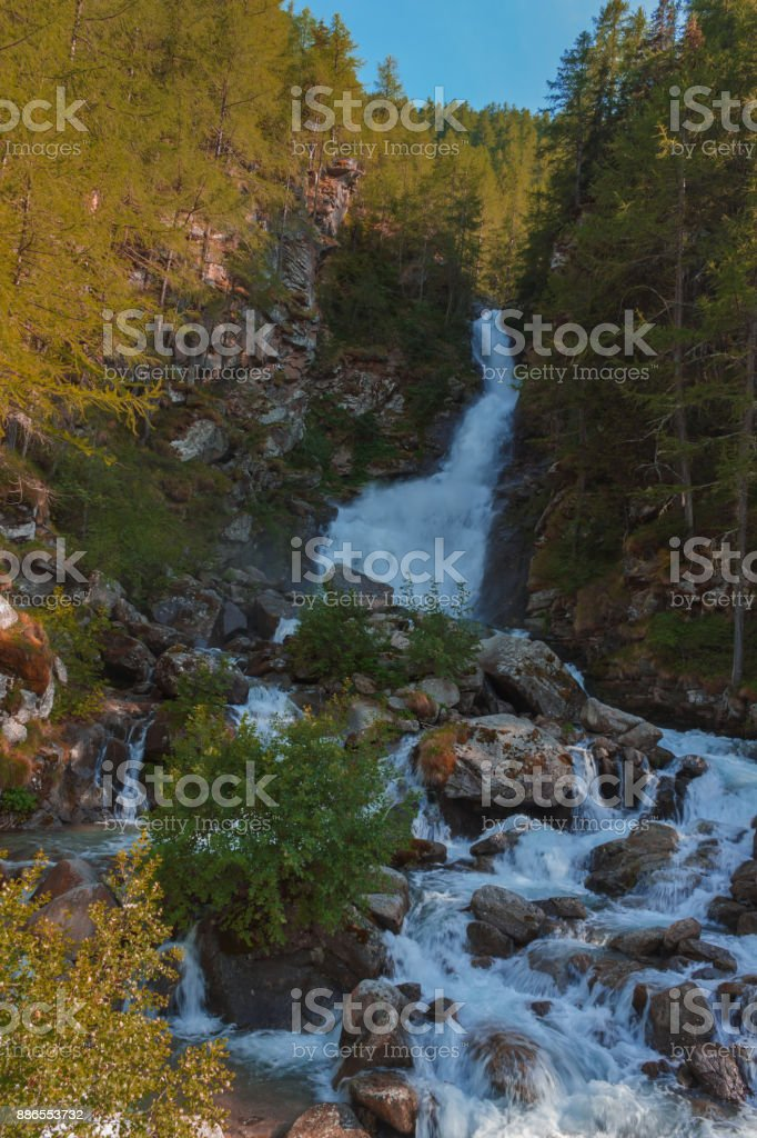 a deafening waterfall falling from glaciers in the National Park of Great Paradise,in Piedmont,Italy. stock photo