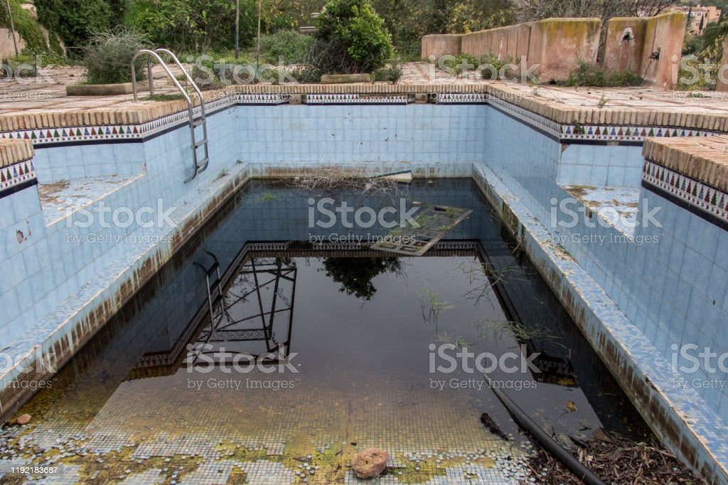 A Dirty And Abandoned Pool With Little Water Stock Photo Download Image Now Istock