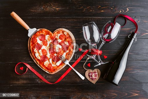 istock a festive dinner of pizza in the shape of a heart and a bottle of wine. 901239802