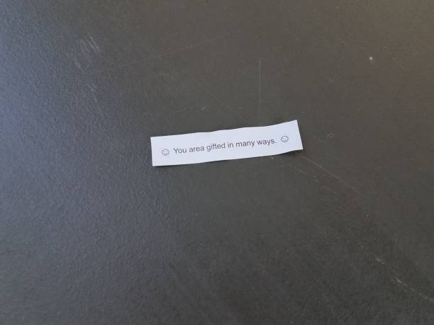 a fortune with a typo that says you area gifted in many ways stock photo