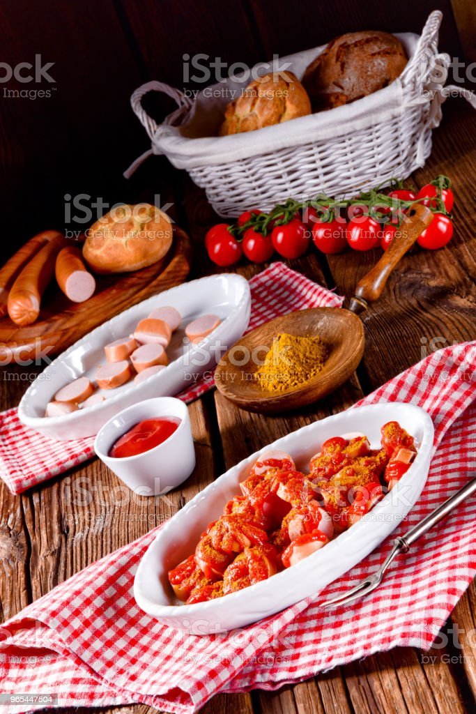 a fresh and tasty sausage in curry sauce royalty-free stock photo