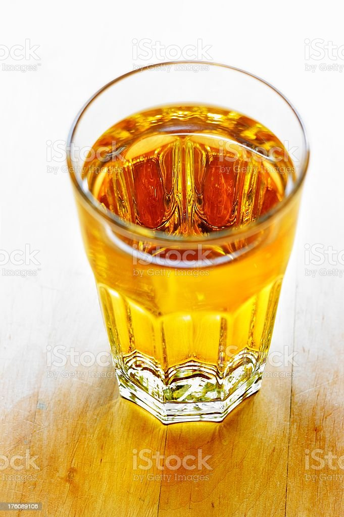 a glass of apple juice on a wooden table royalty-free stock photo