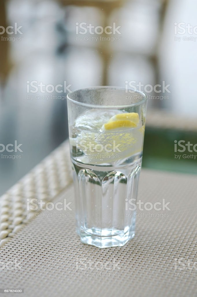 a glass of carbonated water stock photo
