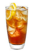 a glass of frozen lemon black tea on a white background,Many ice cubes and lemon slices.