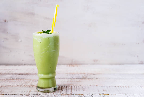 a glass of green tea smoothie stock photo