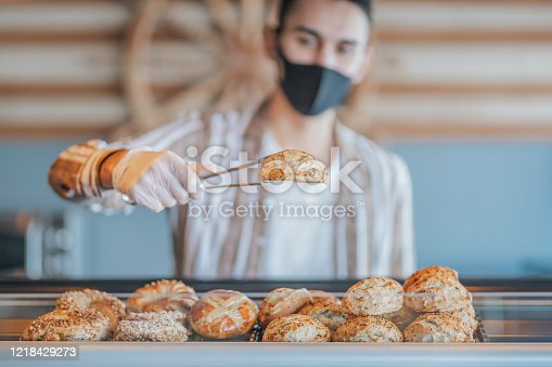 a gloved hand that chooses a pastry