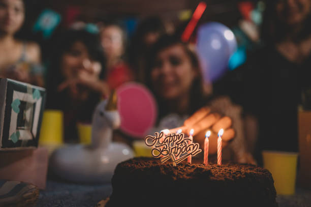 a group of asian friends gathering weekend together celebrating birthday at night stock photo