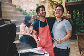 istock a group of asian multi ethic young adults gathering at villa during weekend for city break enjoying barbecue session 1152122429