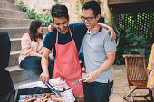 istock a group of asian multi ethic young adults gathering at villa during weekend for city break enjoying barbecue session 1152122462