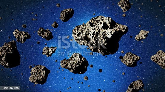 istock a group of asteroids in front of a star background 953157150