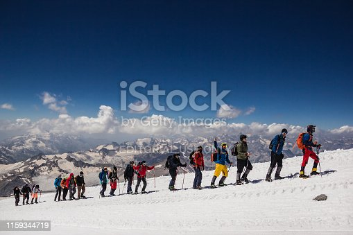 Russia, Elbrus - JULY 29, 2018: a Group of climbers lined up one after another go to the top of the mountain.every year thousands of tourists go to the mountains.