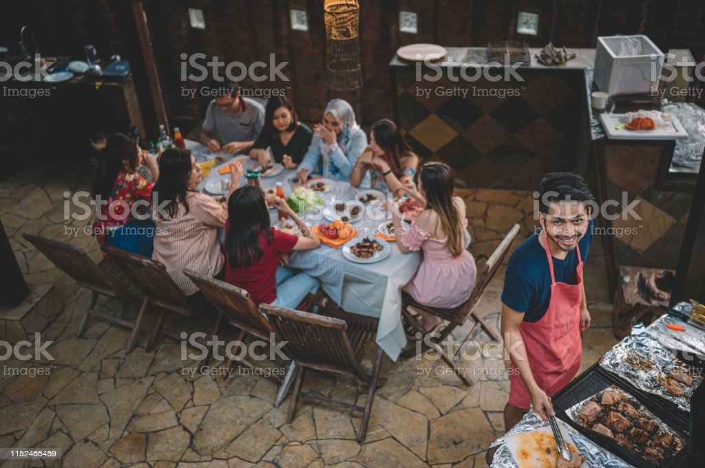 a group of multi ethic friends gathering at villa during weekend for...