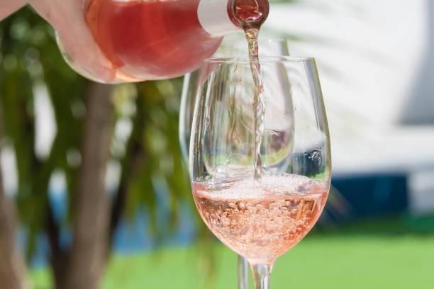 A hand of woman pouring delicious rose wine picture id1217283488?b=1&k=6&m=1217283488&s=612x612&w=0&h=k0ewilrcpckwocnpqw6iicnw7pi8ike2m0dbgf6lnsy=