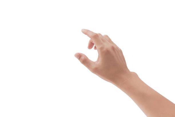 una mano tocando algo como un dispositivo de botón o pantalla en fondos blancos, aislado - física fotografías e imágenes de stock