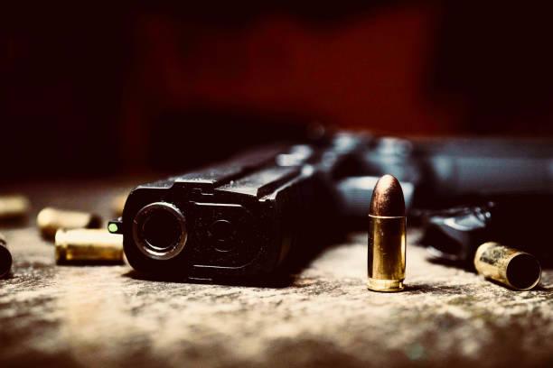 a handgun and it's bullet iv - proiettile foto e immagini stock