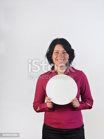 a happy woman holding a plate