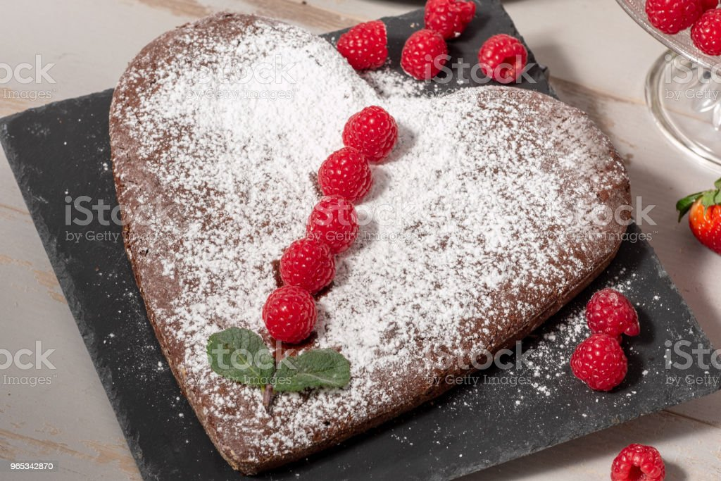 a heart shaped chocolate cake with strawberries royalty-free stock photo