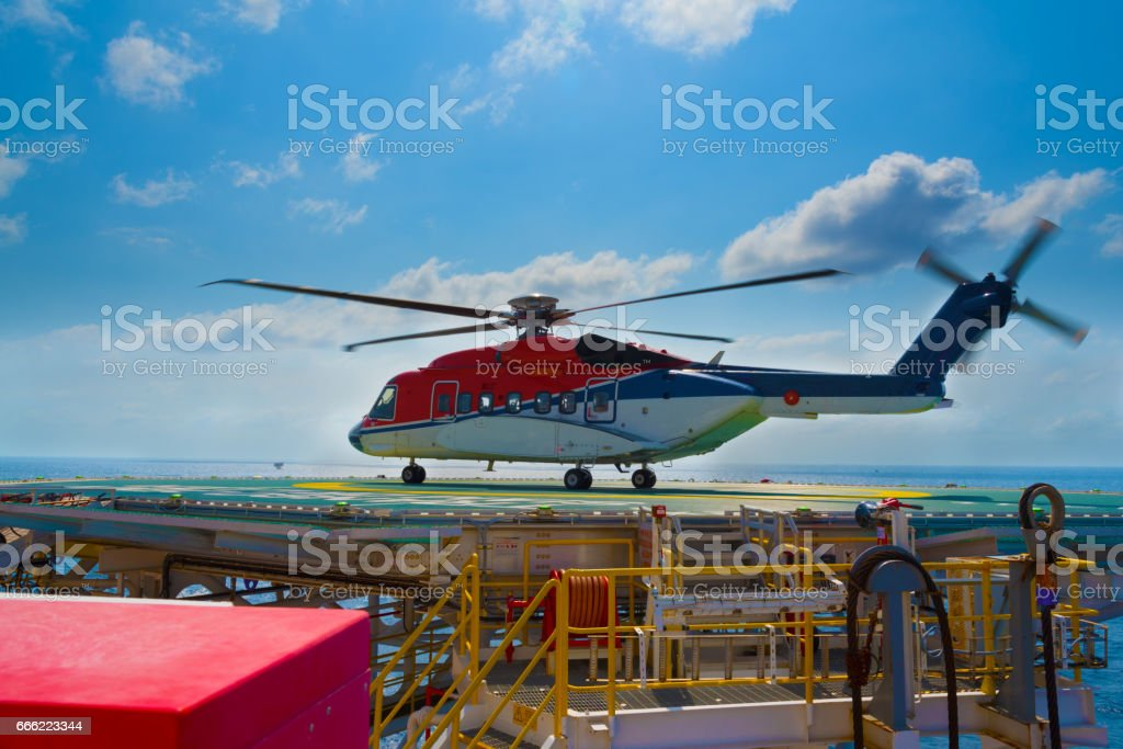 a helicopter landed on offshore drilling rig stock photo