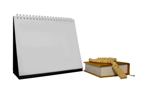 a holy quran and calendar stock photo