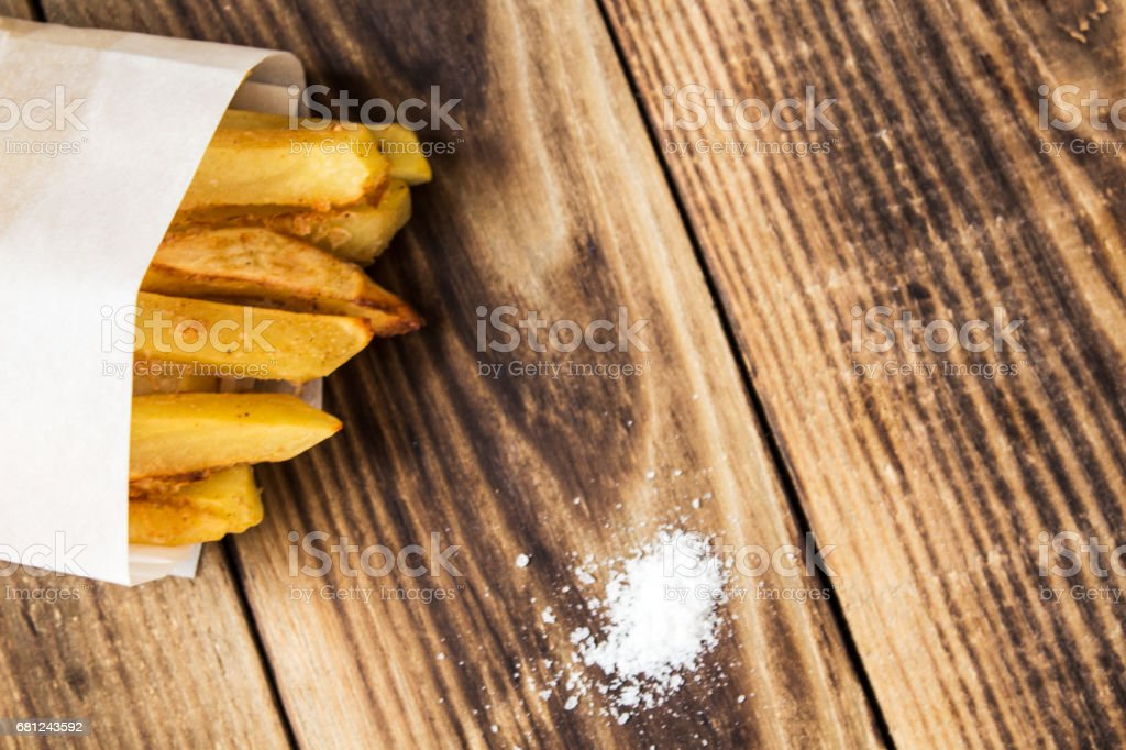 a homemade french fries on wooden royalty-free stock photo