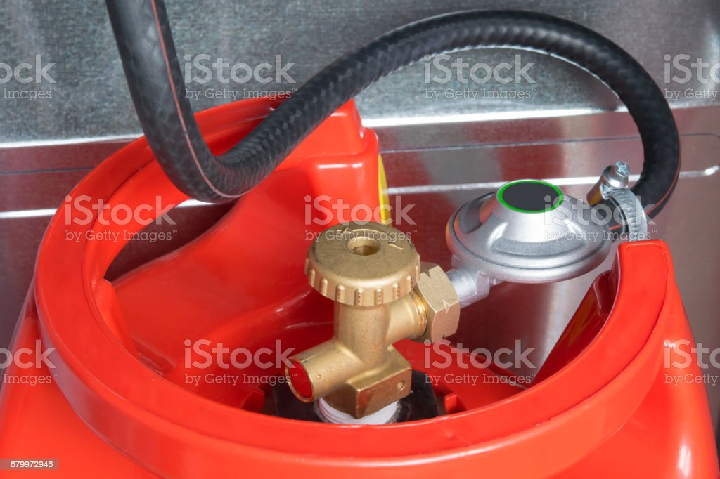 a hose connected to the cylinder red gas supply stock photo