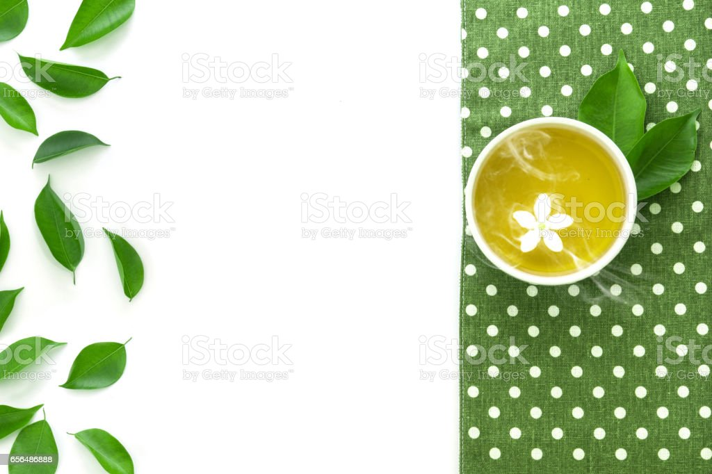 a hot cup of tea with green leaf decoration stock photo