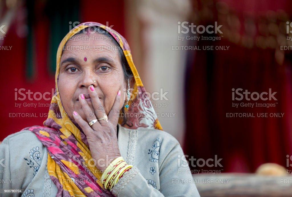 a indian tribal lady in pushkar camel fair stock photo