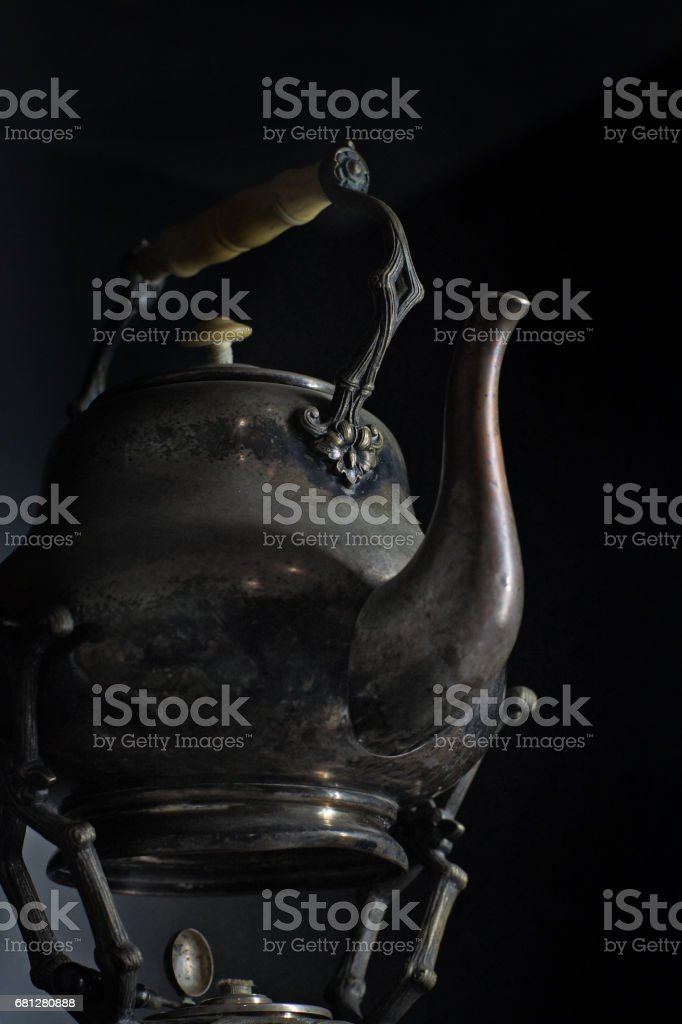 a jar of honey and cinnamon sticks on black background royalty-free stock photo