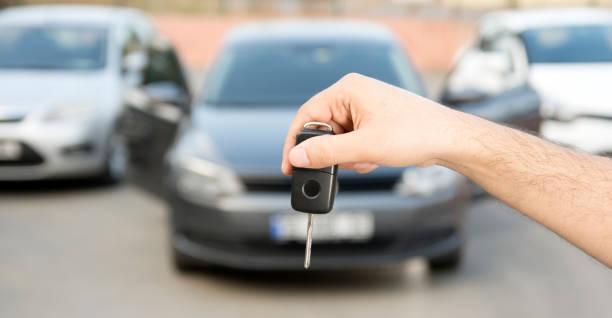 a key and three automobiles stock photo