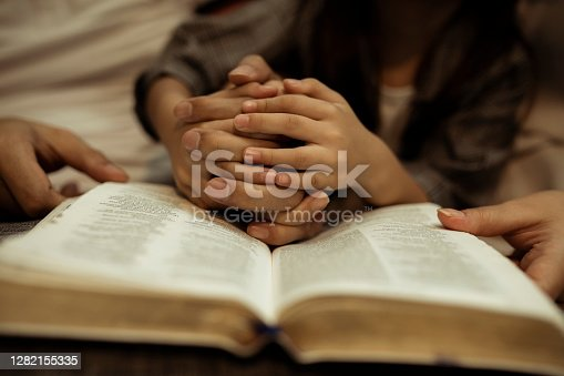 istock a kid reading the holy bible 1282155335