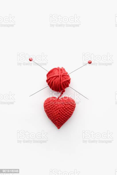 A knitted heart of red thread with an inserted knitting needle on a picture id901618046?b=1&k=6&m=901618046&s=612x612&h=d4sedbor1fanpjmx5cjqwibjwf5aivfrobmwqcf9l6y=