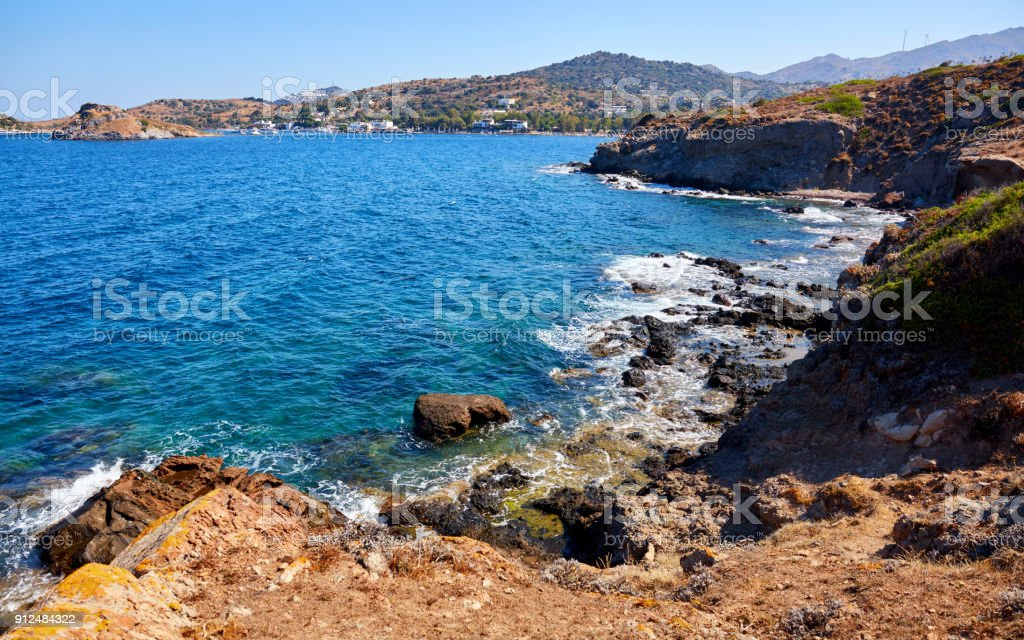 a landscape view of Bodrum Gumusluk (Myndos) bay in Turkey, cliff, sea and the rabbit island. stock photo