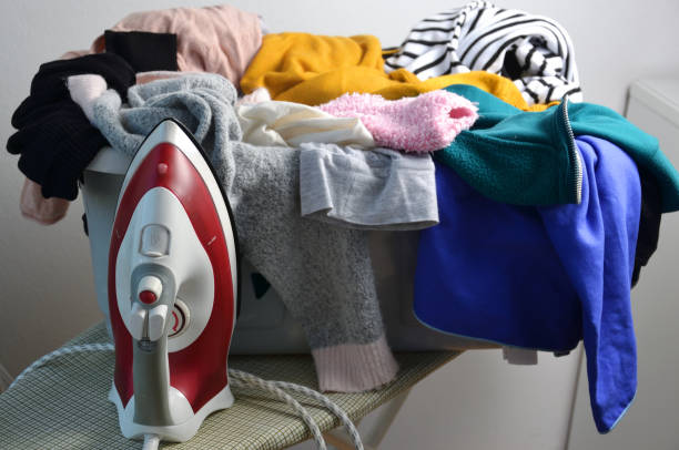 a laundry basket full of clothes stock photo
