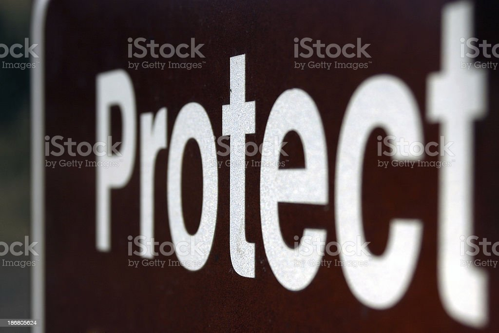 a leterring sign at national park : ' protect ' royalty-free stock photo