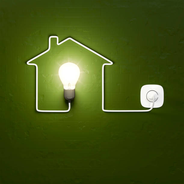 a light bulb building a house with the cable stock photo