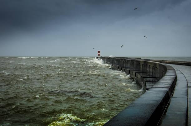 a lighthouse on a stormy sea - rain clouds porto portugal imagens e fotografias de stock