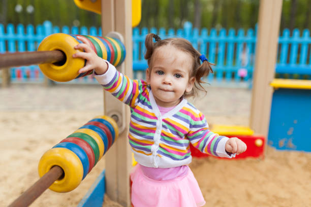 royalty free two girls one sandbox pictures images and stock photos