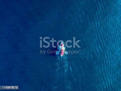 a lone yacht swim in deep blue ocean top view