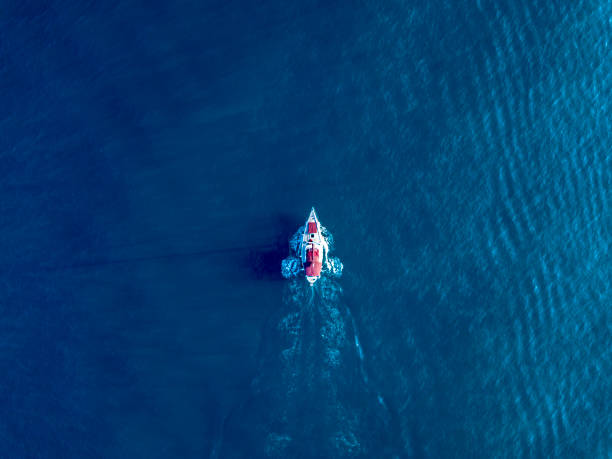 A lone yacht swim in deep blue ocean top view picture id1140679210?b=1&k=6&m=1140679210&s=612x612&w=0&h=0n4dkewe22asmv9 d9n ry9 ocgnxgwqt y41xswhxw=