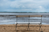 a lonely bank on a beach at ebbe