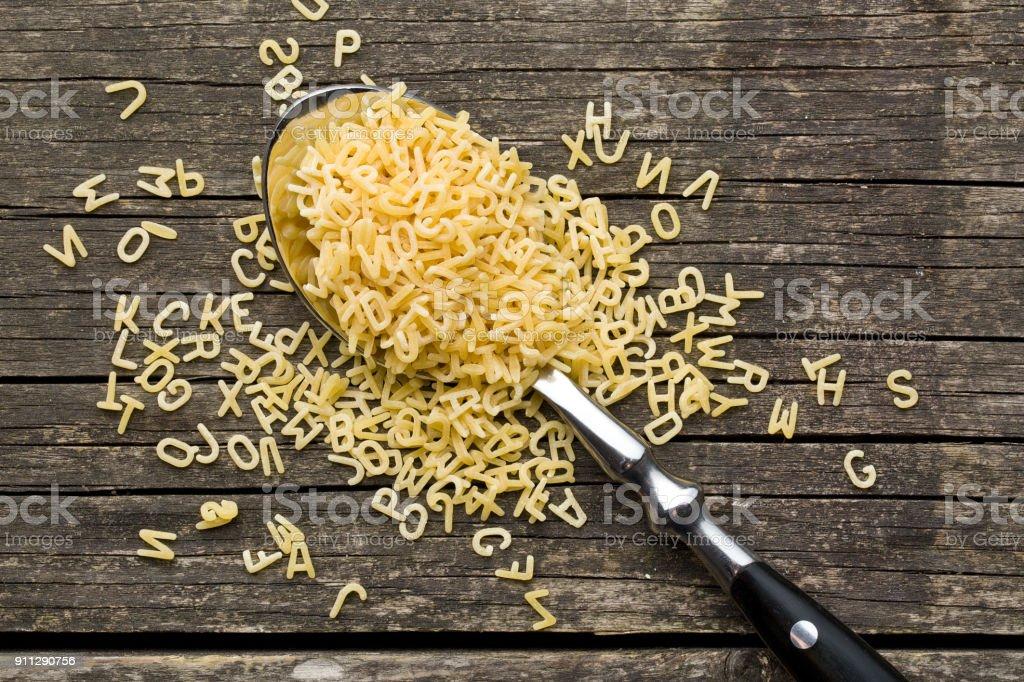 a lot of alphabet pasta stock photo