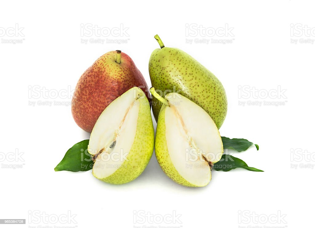 a lot of big, ripe, bright pears. pears on a white background, whole and in cross section. zbiór zdjęć royalty-free
