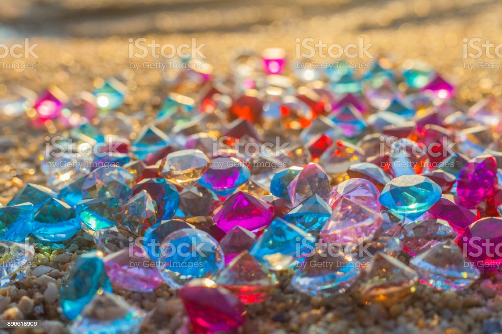 a lot of diamonds are scattered about on the beach stock photo