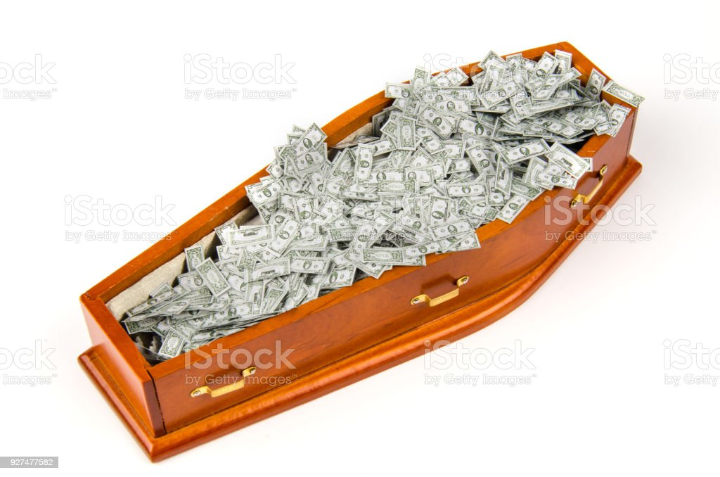 a lot of Dollar notes in Coffin - symbol for Dollar crisis, heritage, money laundering stock photo