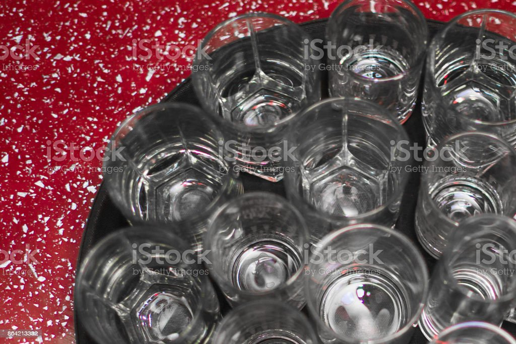 a lot of empty wine glasses on a tray royalty-free stock photo