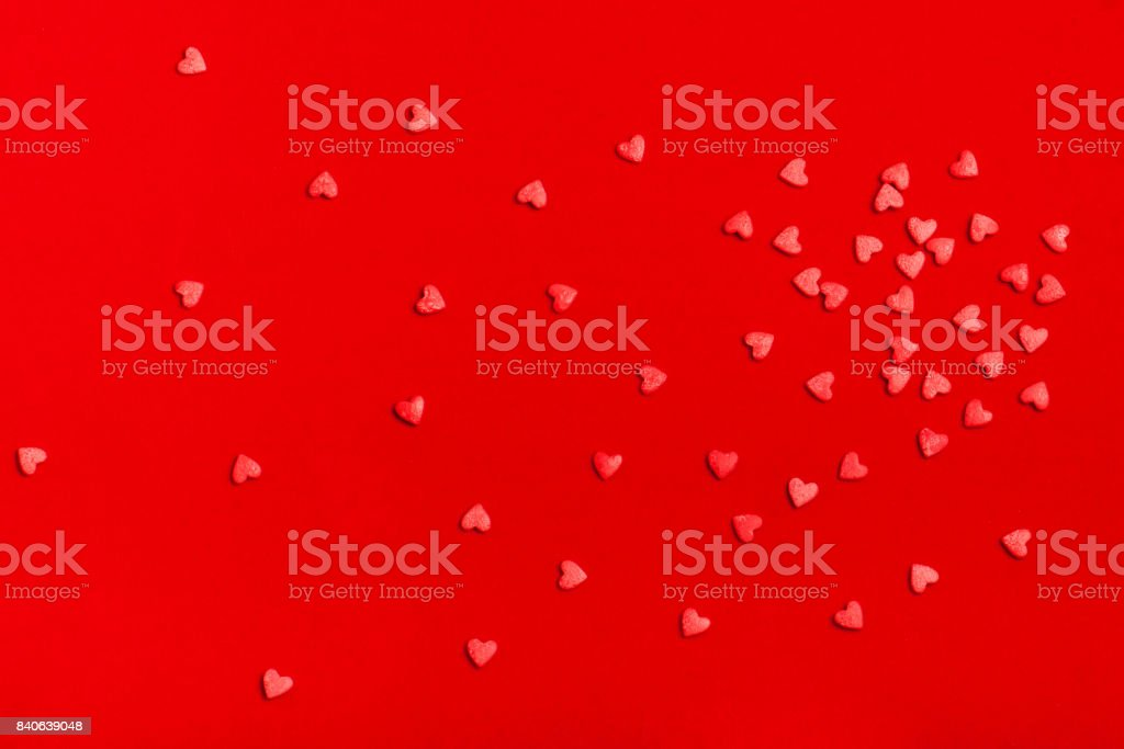 a lot of hearts on a red background stock photo
