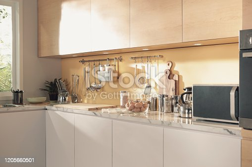 839034546 istock photo a lot of kitchenware on the kitchen counter 1205660501