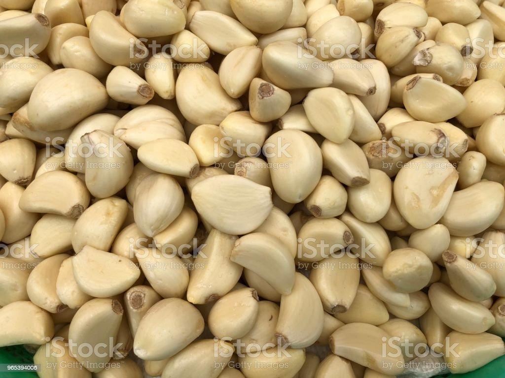 a lot of peeled garlics royalty-free stock photo
