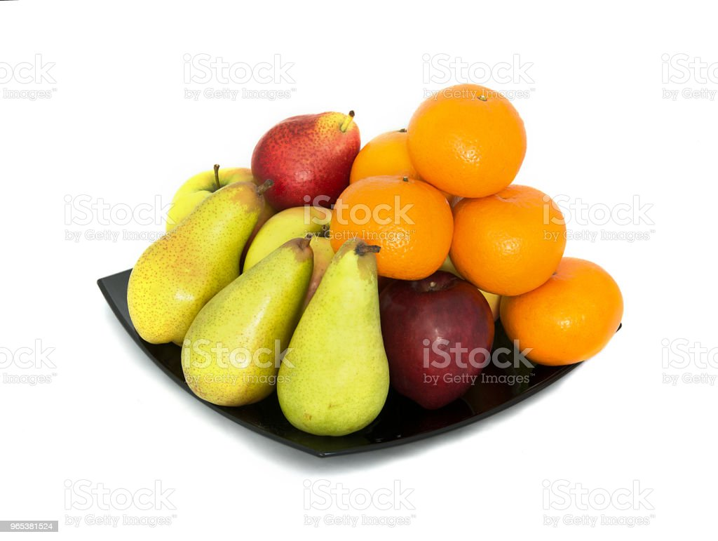 a lot of ripe and juicy fruit on a white background. Apples and pears and Mandarin together. royalty-free stock photo